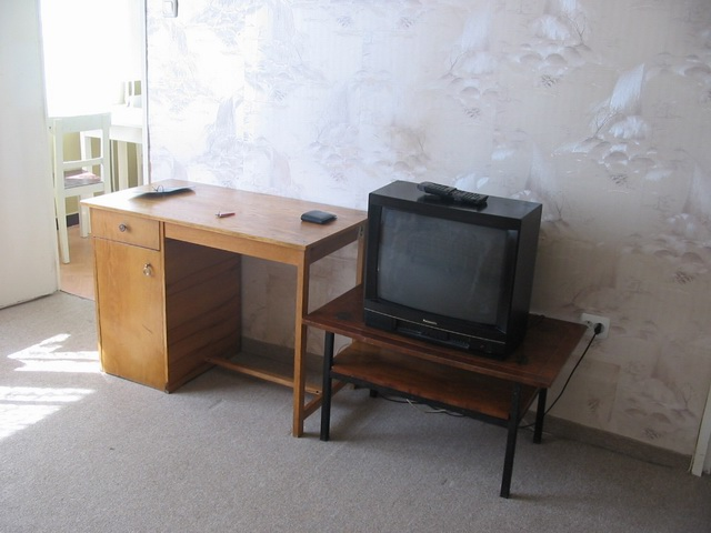 View of the TV table with the TV on it