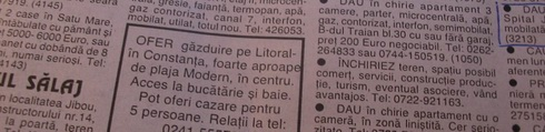 Browsing the ads in the newspaper